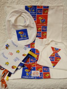 Kansas Jayhawk Baby Gift. I must vaccinate this child from the many hours it will spend in Columbia, Misery!!!