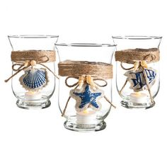 Add coastal appeal to your kitchen counter or coffee table with this eye-catching glass candleholder, showcasing a burlap accent.