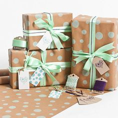 Brown paper with a couple different sizes of stamped dots and matching ribbon