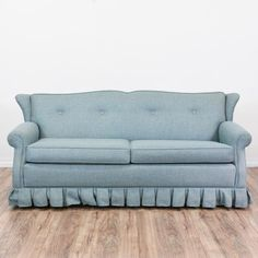 Cool retro-looking sofa with full sized mattress included. Beautiful blue color looks much richer in person. Pull-out function has been tested and works great! Upholstery and structure in excellent condition.  72.5x37.5x33 Deployed: 72.5x102.5x29·Material: Wood   ·Condition: Very good   ·Number_of_pieces: 1   ·Dimensions: 72.5x37.5x33   Available now on Loveseat.