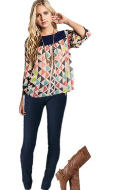 Eye catching tunic shift looks great with a pair of trouser jeans and a trendy boot!