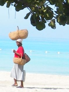 miss curtis.... she carries this 40 lb. basket of fruit to sell on the beach all day long