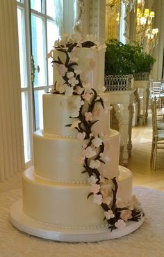 Fondant cake with chocolate branch and sugar flowers