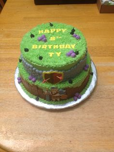 """8"""", 10"""" clash of clans cake. In buttercream - piped boulder wall, piped wooden slat wall, piped shield, toothpick arrows. In royal icing - cannon ball bombs, fuel balls, barbarian king, lettering in clash of clans font. Grass tip edges and top with buttercream 10th Birthday, Birthday Parties, Birthday Cakes, Birthday Ideas, Barbarian King, Zombie Party, Clash Of Clans, Royal Icing, Sweet Recipes"""