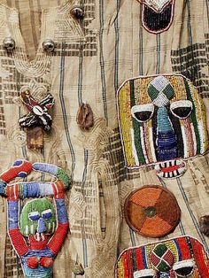 Africa | Beaded details from a Tunic from the Yoruba people of Nigeria | Done of Yoruba Ashoke strip woven textiles