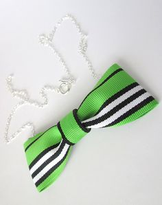 Green, black and white striped bow tie necklace on Etsy, $14.00