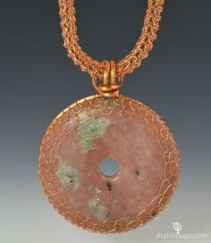 Rhodonite pendant with a crocheted wire chain, and bezel.