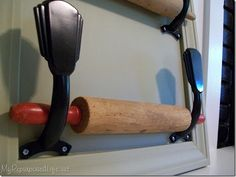 Use vintage spoons for rolling pin holders!  (This pic uses a repurposed ceiling fan blade holders.)