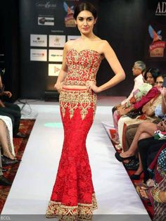 Red lengha by AD Singh during Kochi Fashion Week 2013.