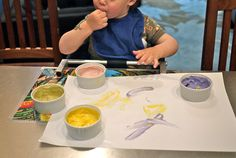 If your kids are still interested in eating finger paints, don't fight it! We've got 5 fantastic edible finger paint recipes, all safe for little artists.