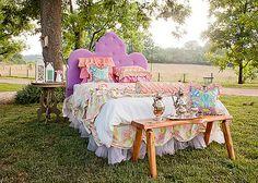 The great outdoor bedroom.  Not sure I would put a velvet headboard outdoors in Nebraska??