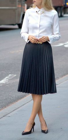 White long sleeved collar shirt with black pleated skirt. | Office Style