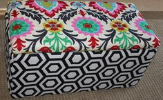 Gorgeous mulit coloured suzani storage ottoman measuring 70cm long and 38cm high and 38cm wide and featuring black and beige geometric bootm. THis ottoman is simply stunning and has a lid which comes off to reveal ample storage for book, toys, magazines, blankets etc. THis ottoman is super versatile being used for coffee tables, extra seating ( up to 100kgs), bed side table and toy storage. Each ottoman is custom made and can take up to three weeks to complete as I have to order the fabric…