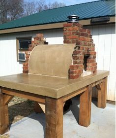 This awesome wood-fired brick pizza oven was the Mattone Barile Grande pizza oven form. A beautiful oven built on one of the most amazing concrete countertop bases (check out those timbers!!). BrickWoodOvens.com