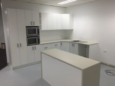 Great office kitchen using laminate bench tops including Island waterfall ends, with melamine doors and drawer fronts.