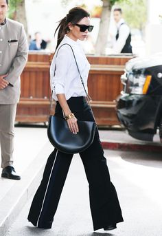 How to Dress Better for Work, According to Victoria Beckham via @WhoWhatWear // Never Underestimate the Power of Great Basics: a white button-down and tailored pants.