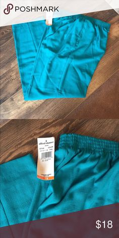 "ALFRED DUNNER Pants sz 18 Turquoise pants by Alfred Dunner.  Size 18 with an elastic waist measuring 14.5"" unstretched and an inseam of 29"".  2 front pockets.  New with tags! Alfred Dunner Pants"