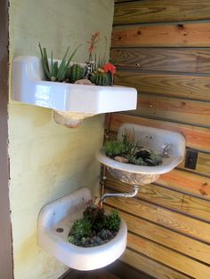 antique sink planters. awesome. Add pipes to the sink and turn into a fountain with multiple sinks.