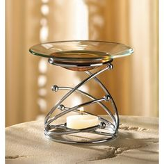 """Unique decorative silver metal """"Modern Swirl"""", scented oil warmer with glass warming dish. This contemporary oil burner will compliment any home decor and add a fragrant ambiance to any room."""