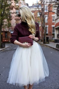 How to Style a Chunky Knit Sweater - deep wine colored sweater + matching clutch worn with an midi length tutu skirt | StyleCaster