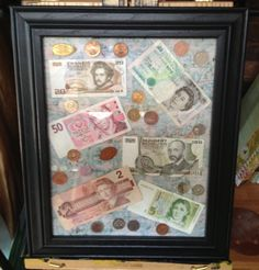 Getting Crafty with all the random foreign money we had around the house!  So much more fun to display it than hide it in a drawer!  Extra space to add more!
