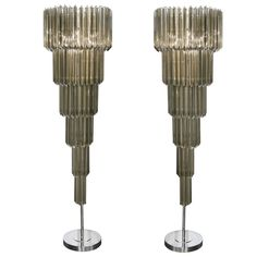 Exuberant Pair of Floor Lamps  :  Venini.  Smoky Murano glass, chrome.  Italy      c1960's