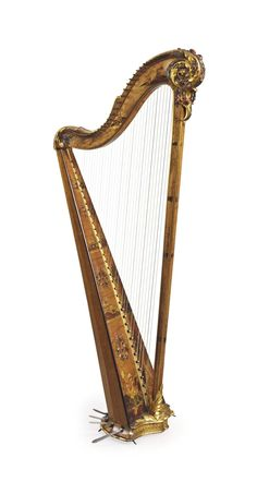 A LOUIS XVI GILT-JAPANNED AND POLYCHROME-DECORATED VERNIS MARTIN HARP BY COUSTINEAU PERE ET FILS, CIRCA 1780