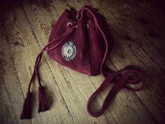 Handmade leather pouch bag Check it here: http://www.individual.gr/p.Dermatino-cheiropoiito-pougkaki-me-metalliko-skalisto-louloydi.790229.html