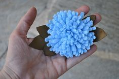Felt chrysanthemum!  Another flower that goes together fast once you have all of the cutting done.  Especially pretty in fall colors.