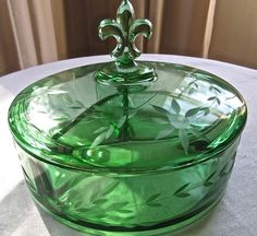 Fostoria 1930's depression etched covered candy dish.  Ahh, green + depression glass+ Fleur de lis!!! I will find this some day