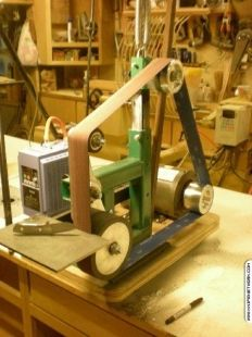"""Homemade 2""""x72"""" belt sander powered by a 2HP 1750 RPM motor. Features a 4-position rotary head and inverter-variable speed control."""