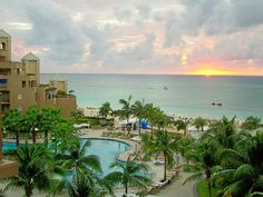 CARRIBEAN  ISLAND SUNSET-ON 7 MILES BEACH, FROM THE RITZ HOTEL SUITE.