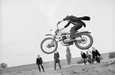1966. An Etonian Jumping On A Motorcycle.
