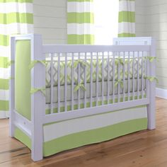 "Kiwi and Gray Winston Baby Boy Crib Bedding.  Kiwi and Gray Winston combines the fun geometrical shapes and wide horizontal stripes with the fresh colors of grays and greens. These refreshing colors will look great in your nursery. The modern design will create a ""must have"" contemporary look that can grow with your child."