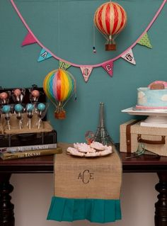 Alice's hot air balloon party - dessert table.  I did this - bunting, table runner, and all.