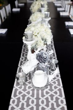 white bouquets with candlesticks