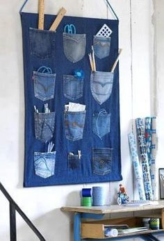 Re-purpose jeans...great for organizing gardening stuff, kid's rooms or the garage!