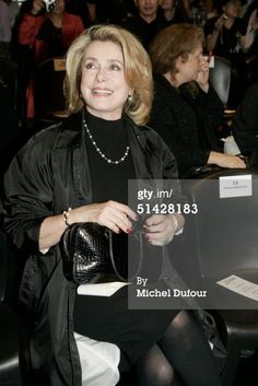 Actress Catherine Deneuve attends the Jean Paul Gaultier fashion show during Paris Fashion Week (Pret-a-Porter) Spring/Summer 2005 October 5, 2004 in Paris, France. (Photo by Michel Dufour/WireImage)