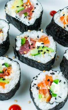 An easy-to-follow homemade sushi tutorial with lots of tips, tricks and photos to help you roll like a pro along with sushi roll and sauce recipes galore!