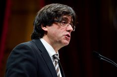 Carles Puigdemont gives a speech during the parliamentary session debating on his investiture as the new President of Catalonia on January 10, 2016 in Barcelona, Catalonia.