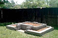 My cinder block raised garden bed - it looks SO much better now with vegetable plants!