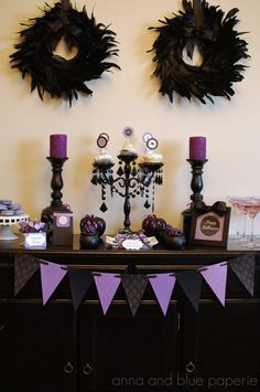 Sure, orange and black is a classic Halloween color combo. But think outside the traditional. This purple and black vignette is just as spooky. See more at Anna & Blue »   - HouseBeautiful.com