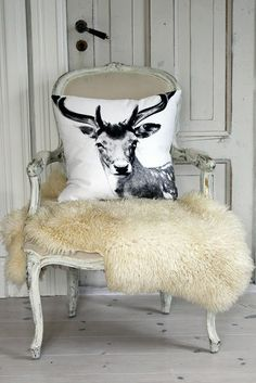 I so want a sheep skin, and look babe a reindeer pillow. LOL