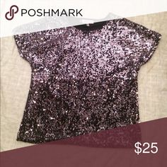 Jennifer Lopez Top Who loves sequins? If so here's a fully sequined top from Jennifer Lopez! Sequins have a hint of purple and black depending on how the light hits them! This a pretty stand out shirt! Size medium. Jennifer Lopez Tops Blouses