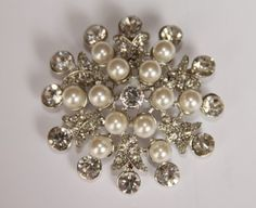 Vintage pearl broach for wedding dress?