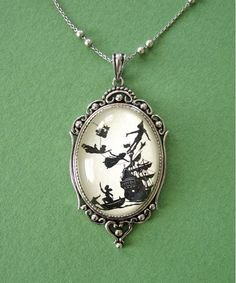 Peter Pan Pendant. This is the most wonderful necklace I have ever seen. I want it so bad.