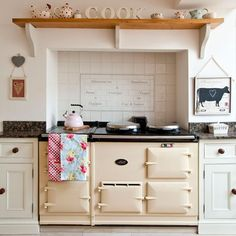 """Set a classic cream Aga into a chimney breast with a mantel shelf above to create the quintessential country kitchen. Classic Kitchen, Vintage Kitchen, Vintage Oven, 1930s Kitchen, Kitchen Rustic, Aga Kitchen, Kitchen Cabinets, Kitchen Cooker, Kitchen Worktop"