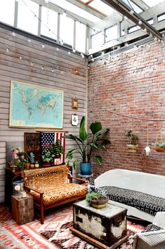 I love the brick, wood, map and lights in this room. Plus that open skylight ceiling! So awesome!