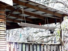 Sue Jordan's bird feeder trough is made of two planks of wood hung with rope.  Easy!