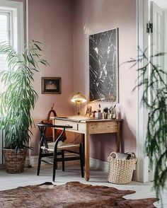 The blush pretty pink hue has become so synonymous with the latest trends in home decor, that it's really the new neutral that belongs in every space. I love this gorgeous workspace.